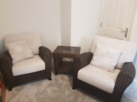 Conservatory cane armchairs and coffee table