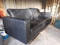 Black leather sofa - needs to be cleaned