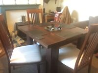 Dining table and four chairs mahogany effect