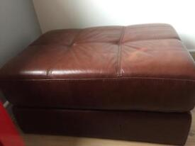 Brown leather pouffe