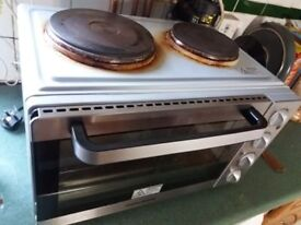 Handy Oven with cooker attached