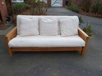 Futon company Oak Futon great condition Very heavy. can deliver.