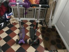 Fab scooters suit 5 to 12 yr olds. In good condition .. just need new grips. One purple one black.