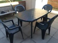 Plastic patio Set and four chairs fully service and ok.