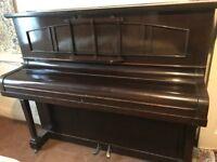 Piano needs urgently a new home. Upright overstrung dark wood est. fifties