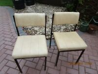 TWO CREAM FAUX LEATHER CHAIRS