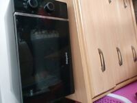Black hotpoint microwave, less than a year old