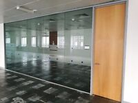 USED TOUGHENED GLASS PARTITIONS WITH WOODEN DOORS & ALL FRAMES £100 PER LINEAR METRE IN CANARY WHARF
