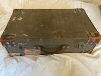 Antique suitcase with leather trim