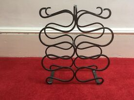 Solid metal wine rack, 20 ins tall x 16 ins wide. Holds 10 bottles.