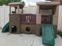 Children's outdoor playhouse with slide