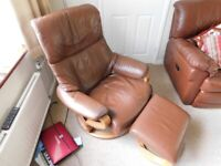 Leather reclining and swiveling armchair with footstool.