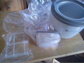 Brand new ice cream maker. Still in plastic cover.