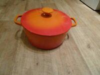 orange and red cast iron pot