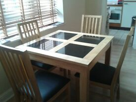 excellent condition small dining table slate inserts complete with 4 chairs with black seats