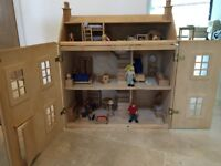 Wooden Dolls House with people and furniture