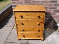 A pine chest of four drawers.