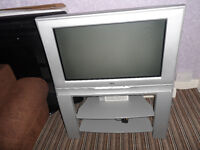 JVC COLOUR TELEVISION ON MATCHING STAND WITH SHELVES INC. POWER CABLE ECCLES CAN DELIVER LOCAL M30
