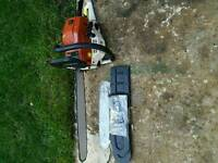 As New NEILSON CHAIN SAW WITH TWO BARS AND. CHAINS