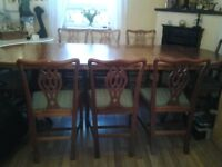 Yew and crossbanded D end dining table
