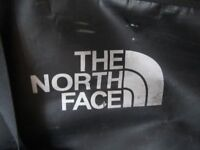 The North face large luggage holdal