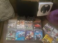 Ps3 and 15 games and 2 controllers