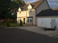 Desirable, well presented, detached 4 bedroom Scotia Home with double garage and very large garden