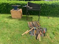 Blacksmiths forge, anvil and various tools