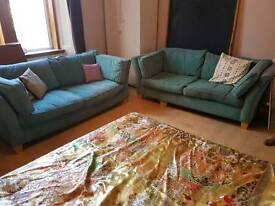 2 lovely teal 3 seater sofas.