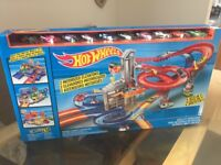 Brand new unopened latest edition hot wheels car track and cars!!!