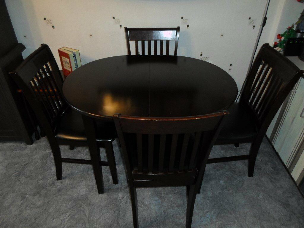 Sturdy dark wood extending table and 4 chairs
