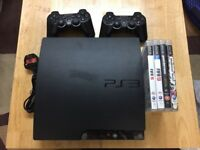 PlayStation 3 with 2 Wireless Controllers & Games