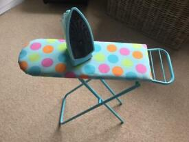 ELC iron and ironing board. Used but still in great condition. Sturdy board with metal legs.