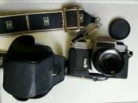 CHINON CS film camera and 50 mm lens.