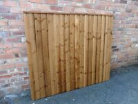 A 6x5 Heavy Duty Brown Treated Fence Panel