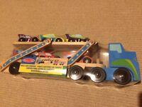 Brand new Melissa & Doug race car carrier wooden toy transporter