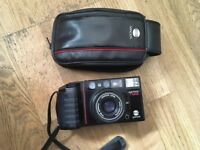 Minolta AF-Tele 35mm Film Camera. 38mm standard, 60mm telephoto lens. Auto focus point and shoot.