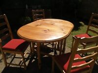 Solid Antique pine drop leaf dining table with four chairs
