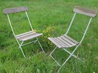 Pair of vintage wrought iron and wood folding garden chairs