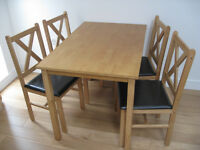 Small and light wooden dining table with 4 chairs