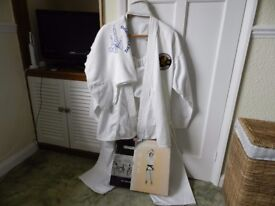 Martial arts suit and book