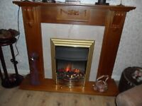 Oak fire surround with fire