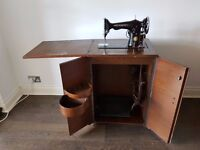 Singer Sewing Machine in Cabinet (Electric/Treadle Convertable)
