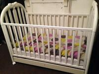 White cot with storage drawer