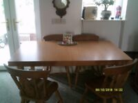 6 or 8 Seat Extending Oak effect laminated Dining table, 4 farmhouse style and 2 Carver chairs