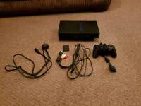 PS2 CONSOLE AND 7 GAMES