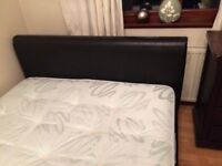 King size bed, black leather base, only 2 years old. Immaculate condition.