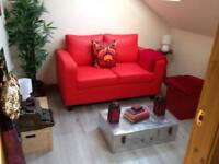 Red 2 seater faux leather sofa