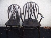 2 vintage farmhouse-dining-kitchen-country style chairs. Two antique style wheel-back chairs. Black.
