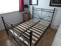 Black Metal Frame double bed. Slatted Base. Excellent condition. will dismantle when sold.